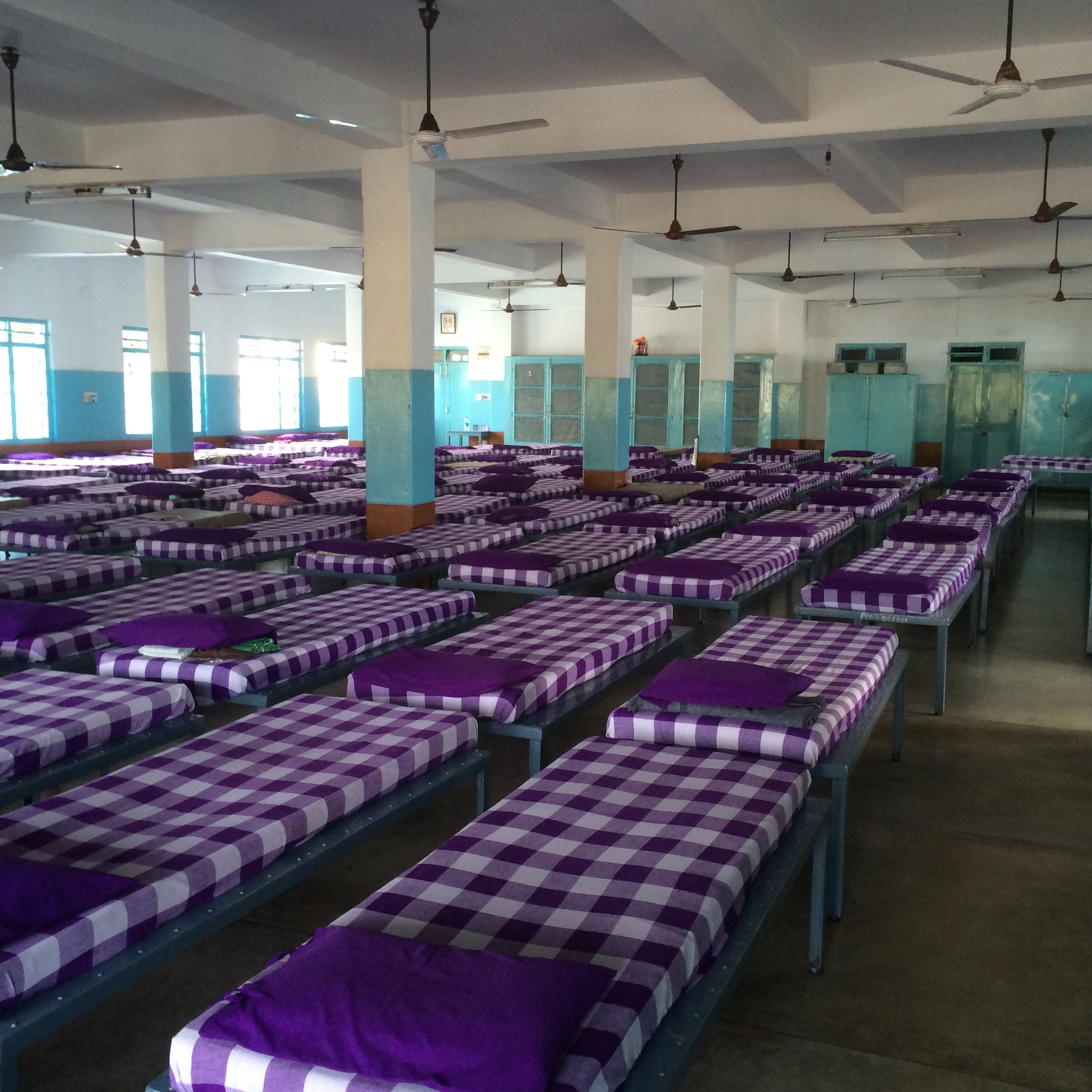 Rows of cots at Prem Dan